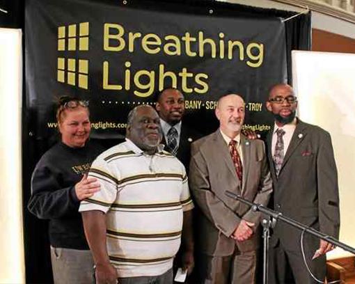 Urban art initiative to raise awareness by illuminating vacant buildings